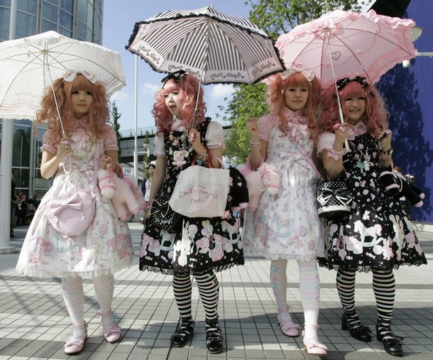 Japanese women dressed in Lolita fashion walk in front of the venue of ...